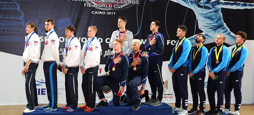 Race Imboden and Miles Chamley-Watson took a knee during the anthem ceremony at the Pharoah's Challenge men's foil fencing World Cup in 2017. (photo: Devin Manky/Getty Images)