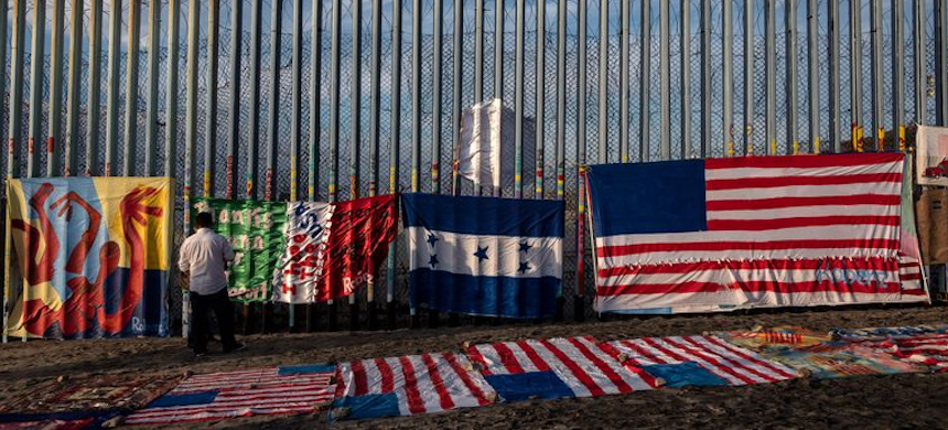 An art exhibition next to a section of the U.S.-Mexico border fence. (photo: Guillermo Arias/AFP/Getty Images)
