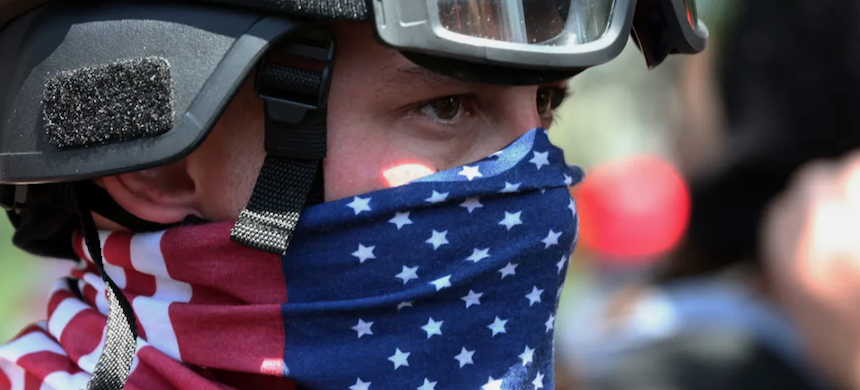 A protester participates in a rally in Portland, Oregon. (photo: Mark Graves/AP)