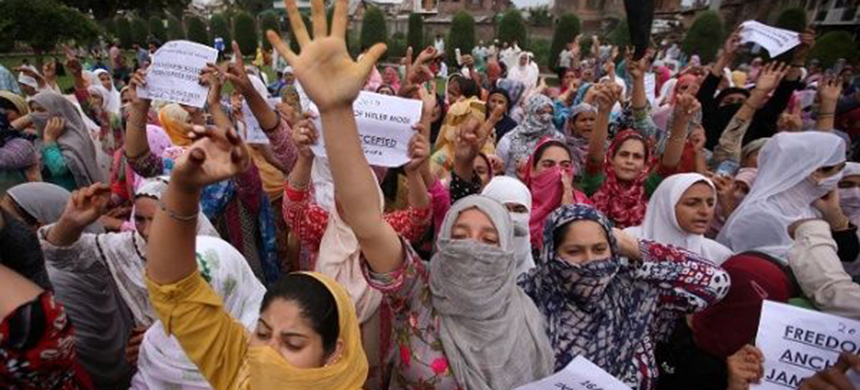 Kashmiri women shout slogans at a protest after Friday prayers during restrictions after the Indian government scrapped the special constitutional status for Kashmir, in Srinagar August 16, 2019. (photo: Reuters)