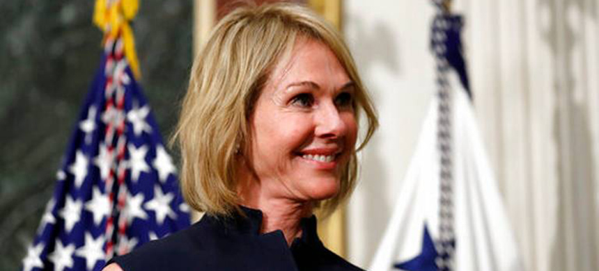 U.S. Ambassador to Canada Kelly Knight Craft stands during her swearing in ceremony in the Indian Treaty Room in the Eisenhower Executive Office Building on the White House grounds in Washington. (photo: Alex Brandon/AP)