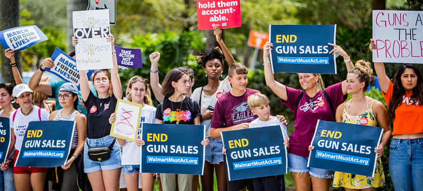 Members of March for Our Lives are joined by members of the community to protest Walmart gun sales in Coral Springs, Florida. (photo: Ian Witlen/Rex/Shutterstock)