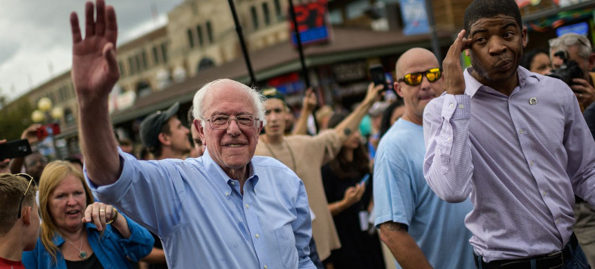 Sen. Bernie Sanders (I-Vt.) waves as he walks through the Iowa State Fair in Des Moines on Aug. 11. (photo: Getty)