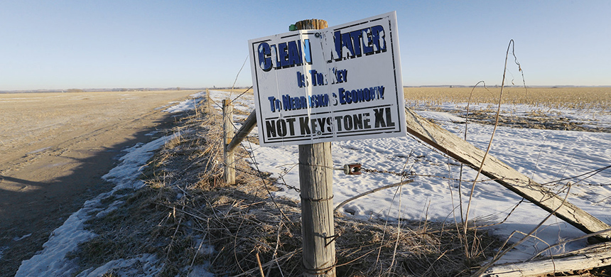 A weather-worn sign protesting the Keystone XL pipeline stands in Fullerton, Nebraska. On Friday the state's Supreme Court dealt the pipeline's protesters a significant defeat, approving an alternate route that runs through Nebraska. (photo: Nati Harnik/AP)