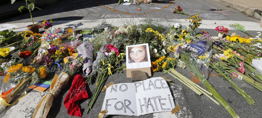 A makeshift memorial of flowers and a photo of victim Heather Heyer sits in Charlottesville, Va., on Aug. 13, 2017. (photo: Steve Helber/AP)
