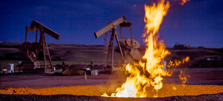 Methane burns off at drilling well. (photo: Orjan F. Ellingvag/Getty)