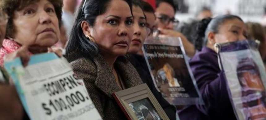 Relatives of missing persons hold signs with pictures of their loved ones during the Second Pacification and Reconciliation Forum, in Mexico City, Mexico September 14, 2018. (photo: Reuters)
