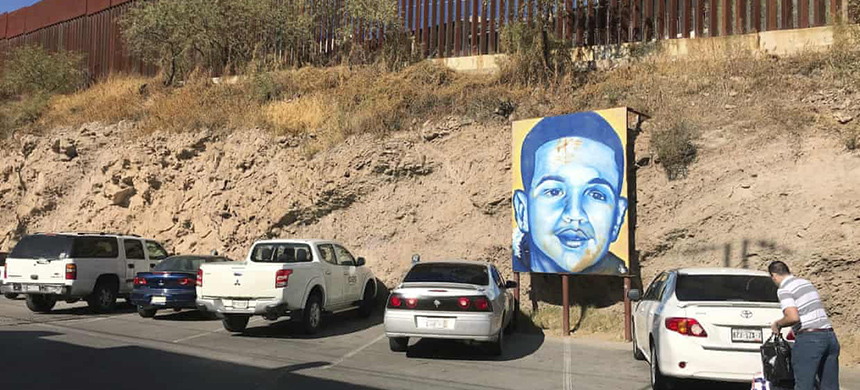 A portrait of José Antonio Elena Rodríguez is displayed on the Nogales street where he was killed. (photo: Anita Snow/AP)