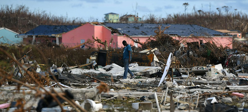 A man searches for belongings among the debris of a destroyed neighborhood off Great Abaco in the Bahamas after Hurricane Dorian. (photo: Loren Elliott/Reuters)
