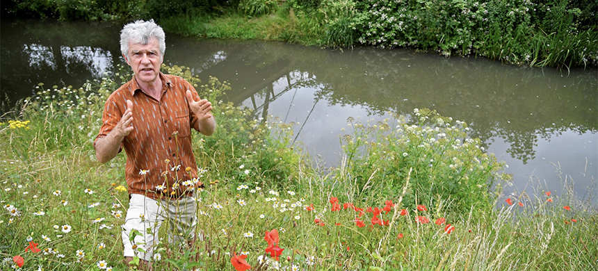 Activist, environmentalist, community leader and undertaker Peter Macfadyen stands on the banks of the River Frome, in Frome, Britain, June 25, 2019. (photo: Toby Melville/Reuters)