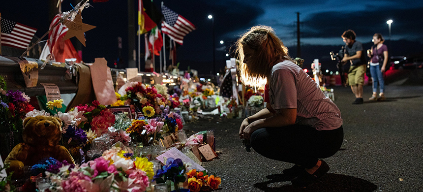 A makeshift memorial for victims of the shooting that killed 22 people at a Walmart store in El Paso last month. (photo: Tamir Kalifa/NYT)