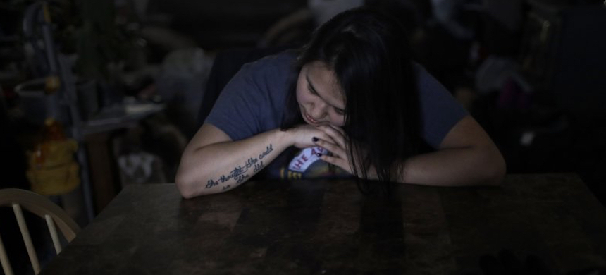 In this Feb. 16, 2019 photo, Deidre Levi rests her head for a moment in her grandmother's house before a basketball game in the Native Village of St. Michael, Alaska. Levi says she spoke up about being sexually assaulted because she wanted to be a role model for girls in Alaska. (photo: Wong Maye-E/AP)