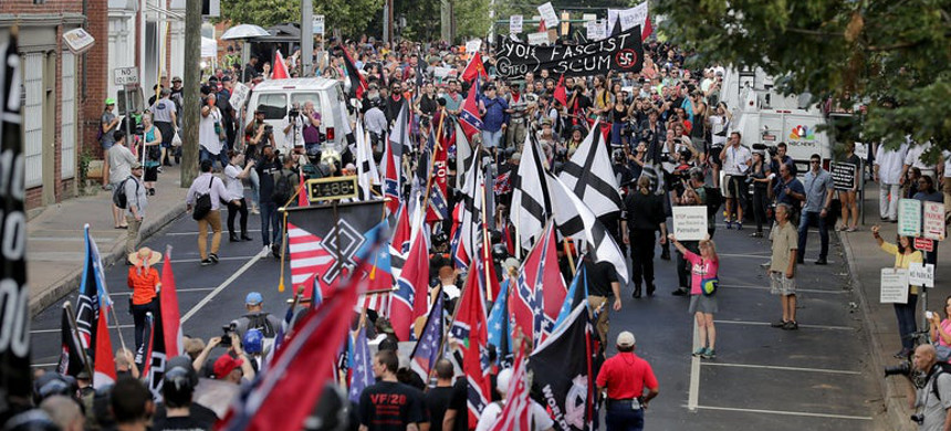 White nationalists, neo-Nazis and other right-wing protesters march toward Emancipation Park during the 'Unite the Right' rally on Aug. 12, 2017, in Charlottesville, Virginia. (photo: Chip Somodevilla/Getty)
