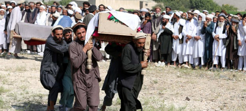People attend the funeral of victims of a U.S. drone strike in Khogyani district of Nangarhar province, Afghanistan, on 19 September. (photo: Ghulamullah Habibi/EPA)
