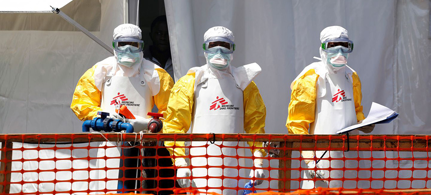 Health workers assist at an Ebola treatment center in Goma, Congo, in August. (photo: Baz Ratner/Reuters)