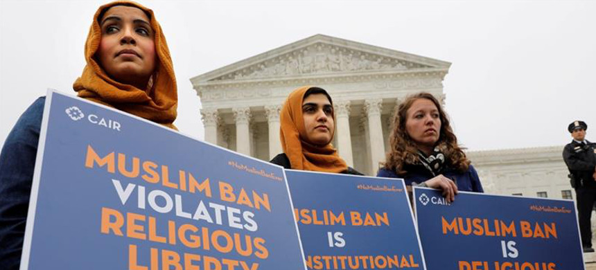 Protesters gather outside the US Supreme Court, protesting the travel ban. (photo: Yuri Gripas/Reuters)