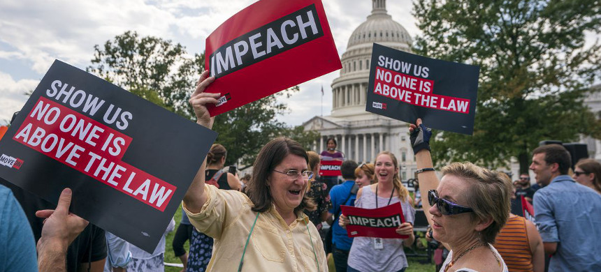 Supporters of impeachment rally at the Capitol in Washington on Thursday, two days after a formal impeachment inquiry against Donald Trump was begun. (photo: J. Scott Applewhite/AP)