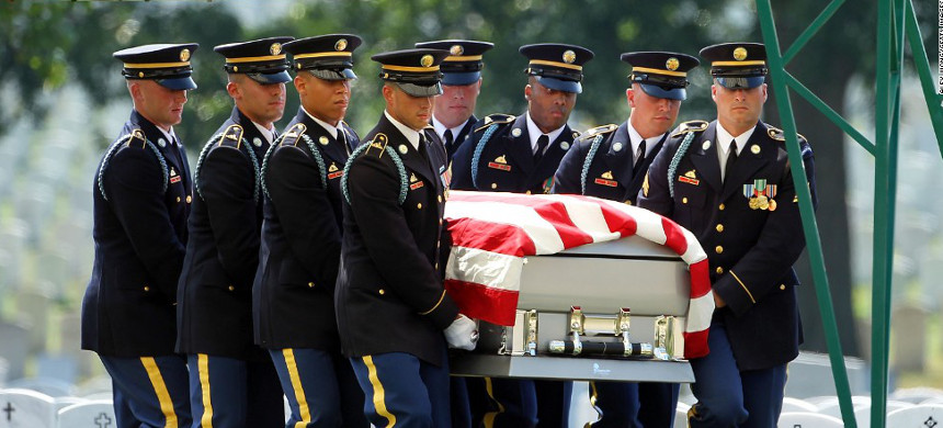 U.S. Military personnel carry a fallen soldier's casket. (photo: Getty)