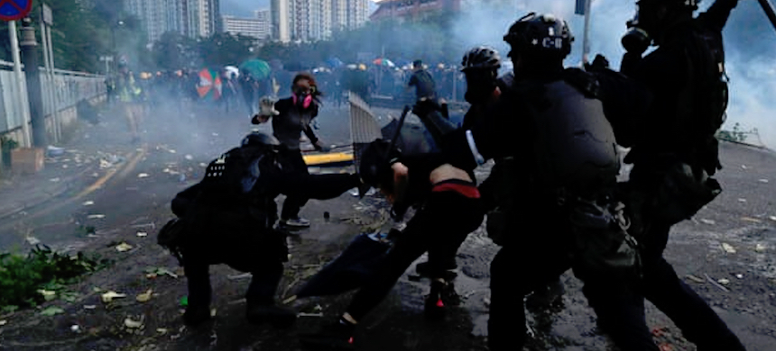 Riot police clash with protesters in the Sha Tin district of Hong Kong. (photo: Jorge Silva/Reuters)