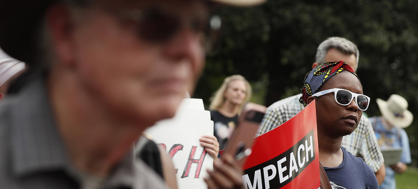 Members of Congress and activists at the 'Impeachment Now!' rally on the grounds of the U.S. Capitol on Sept. 26, 2019. (photo: Paul Morigi/Getty)