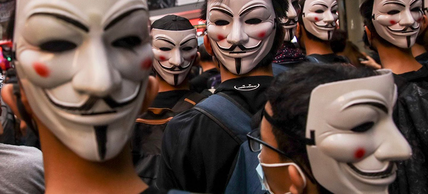 Protesters wearing Guy Fawkes masks take part in a demonstration Oct. 6 against a newly imposed law banning face masks in public in Hong Kong. (photo: Fazry Ismail/EPA-EFE/REX/Shutterstock)