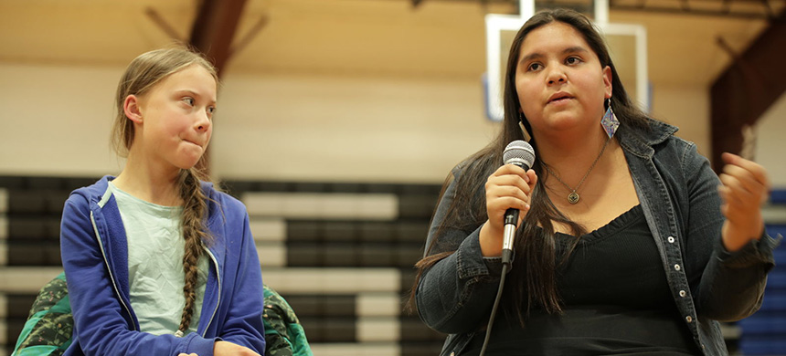 Greta Thunberg, 16, sits next to Tokata Iron Eyes, 16, during the panel Sunday at the Pine Ridge Reservation in South Dakota. (photo: Courtesy of Lakota People's Law Project)