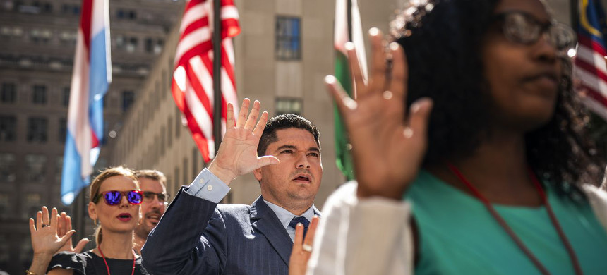 New US citizens recite the Oath of Allegiance during a naturalization ceremony at Rockefeller Center, in New York City, on September 17, 2019. (photo: Drew Angerer/Getty)