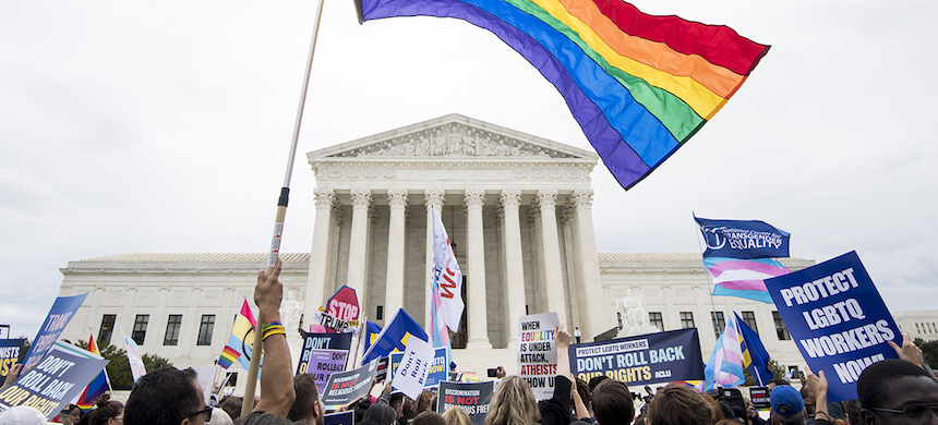 Protesters rally in front of the Supreme Court on Oct. 8, 2019, as it hears arguments on whether gay and transgender people are covered by a federal law barring employment discrimination on the basis of sex. (photo: Bill Clark/CQ-Roll Call/Getty Images)
