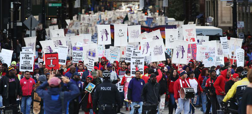 Chicago Teachers Union members and supporters approach Michigan Avenue in the Loop on Oct. 17, 2019, in Chicago. (photo: John J. Kim/Chicago Tribune)