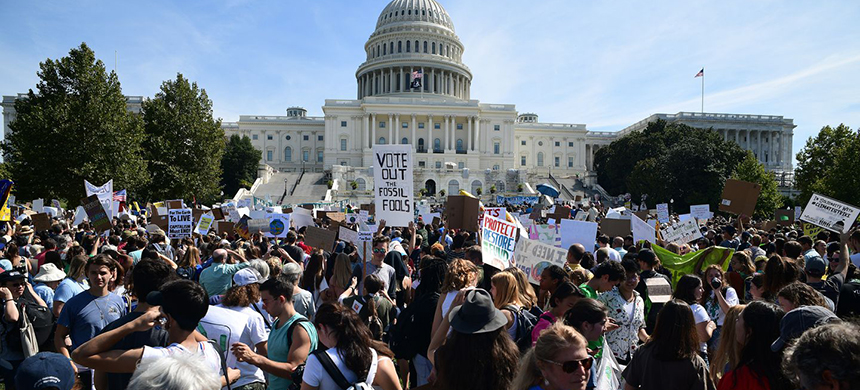 Students protest outside the U.S. Capitol on Sept. 20 as part of a climate strike. They demanded action by lawmakers while chanting 'shame on you.' (photo: Astrid Riecken/WP)