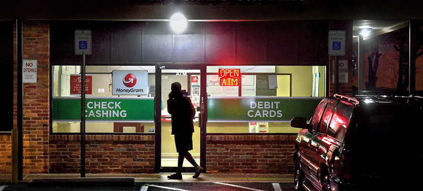 A customer leaves a payday loan store in Maryland. The payday lending industry has been urging the Consumer Financial Protection Bureau to repeal existing rules regulating short-term loans. (photo: Michael S. Williamson/WP)