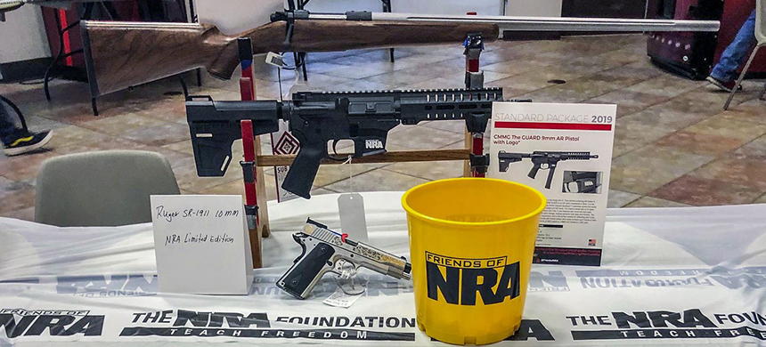 Shotguns and rifles are raffled off Sept. 14 by Friends of NRA at a technology education center in Idabel, Okla. (photo: Neena Satija/WP)