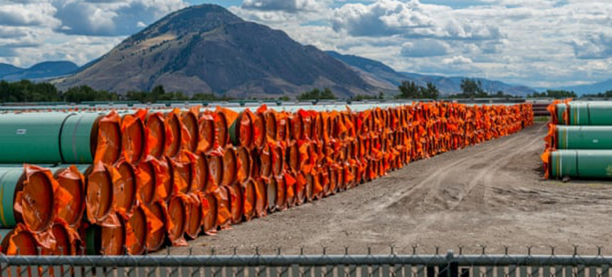 Steel pipe to be used in the oil pipeline construction of the Trans Mountain expansion project lies at a stockpile site in Kamloops, British Columbia, Canada, in June. (photo: Dennis Owen/Reuters)