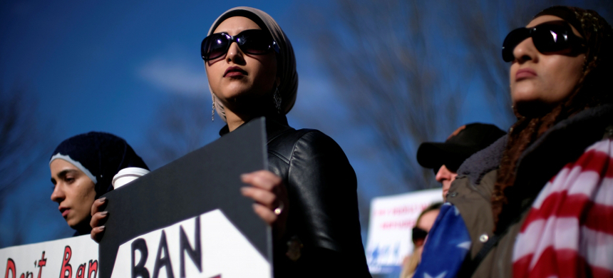 Activist groups including the Council on American-Islamic Relations, MoveOn.org, Oxfam, and the ACLU hold a rally in front of the White House to mark the anniversary of the first Trump administration travel and refugee ban in Washington, D.C., Jan. 27, 2018. (photo: James Lawler Duggan/Reuters)