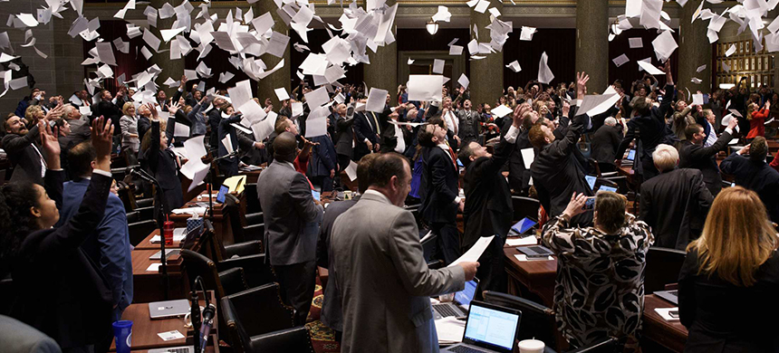 After passing a fetal-heartbeat bill, members of the Missouri House throw papers in the air to mark the end of the legislative session. (photo: The New York Times/Redux)
