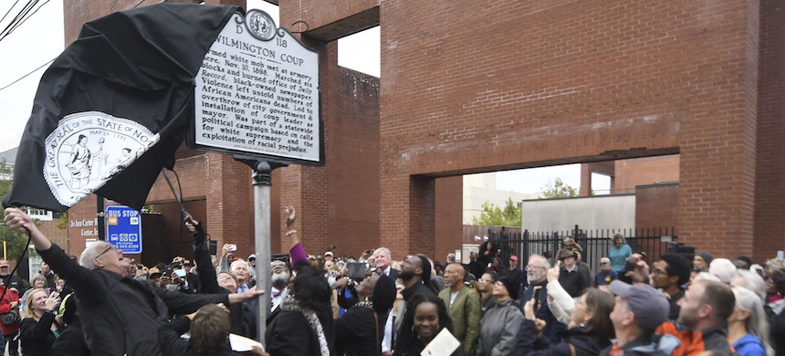 The new North Carolina highway historical marker to the 1898 Wilmington Coup is unveiled during a dedication ceremony in Wilmington, N.C., Friday, Nov. 8, 2019. (photo: Matt Born/The Star-News/AP)
