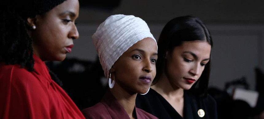 Reps. Ayanna Pressley, Ilhan Omar, and Alexandria Ocasio-Cortez at a July 2019 press conference responding to President Trump's attacks against them. (photo: Alex Wroblewski/Getty)