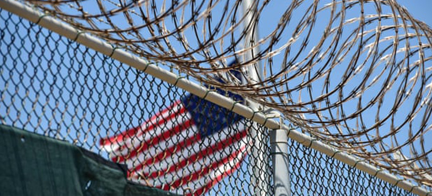 The razor wire-topped fence of Camp 6 detention facility at Guantánamo Bay, Cuba, seen in 2014. (photo: Mladen Antonov/Getty)