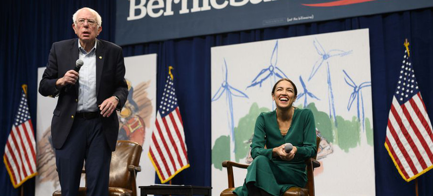 Democratic presidential candidate Sen. Bernie Sanders (I-VT) and Rep. Alexandria Ocasio-Cortez (D-NY) have introduced a bill that would upgrade public housing to be more energy efficient and run on renewable energy. (photo: Stephen Maturen/Getty)