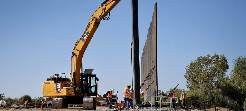 Government contractors erect a section of Pentagon-funded border wall along the Colorado River, in Yuma, Arizona, Sept. 10, 2019. (photo: Matt York/AP)