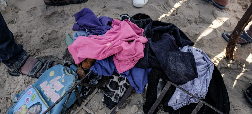 Children's belongings found in the rubble after an Israeli air strike in the Deir al-Balah neighborhood in Gaza Strip. (photo: Fatima M. Shbair/MEE)