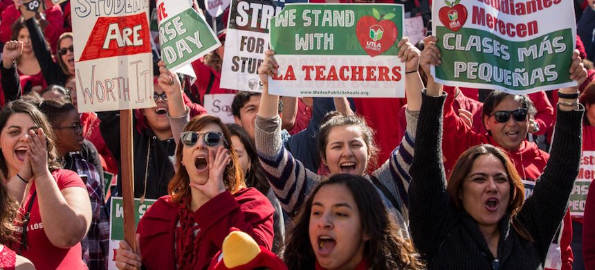 Educators, parents, students, and supporters of the Los Angeles teachers strike wave and cheer in Grand Park on January 22, 2019 in downtown Los Angeles, California. (photo: Scott Heins/Getty Images)