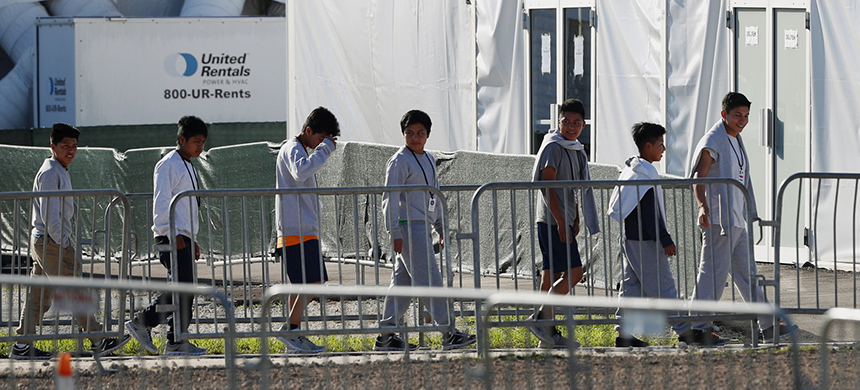 The leader of a U.N. study on children's rights says of the U.S. policy of separating migrant children from their families, 'I would call it inhuman treatment for both the parents and the children.' Here, children are seen near a tent at the Homestead Temporary Shelter for Unaccompanied Children in Homestead, Florida, earlier this year. (photo: Wilfredo Lee/AP)