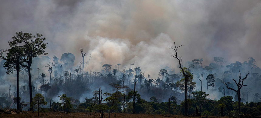 Smoke rises from the fires ravaging the Amazon basin in August. On Monday, Brazilian authorities released data revealing the highest rate of deforestation in the Amazon rainforest in a decade - partly due to a recent surge in wildfires throughout the region. (photo: Joao Laet/AFP/Getty Images)
