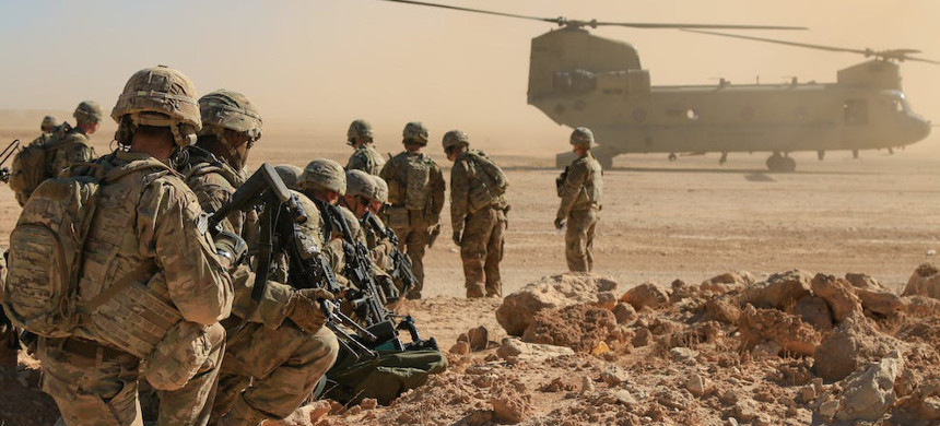 U.S. soldiers deployed in support of Operation Inherent Resolve await aerial extraction during an exercise in Iraq. President Trump made an uneasy connection between veterans and violence that experts say is not supported by evidence. (photo: 1st Lt. Leland White/US Army National Guard)