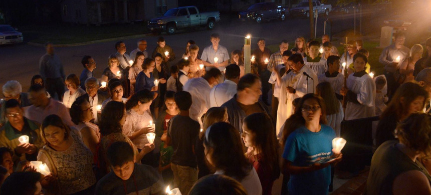 People gather in West, Texas, in memory of those who lost their lives in an explosion at the West Fertilizer Co. plant in 2013. (photo: Dan Zak/The Washington Post)