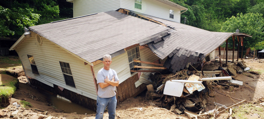 Floodwater that swept down Pigeon Creek hit Eddie Fields' home in Pie, West Virginia, and many of his neighbors' homes in May 2009. (photo: Logan Banner/The Allegheny Front)