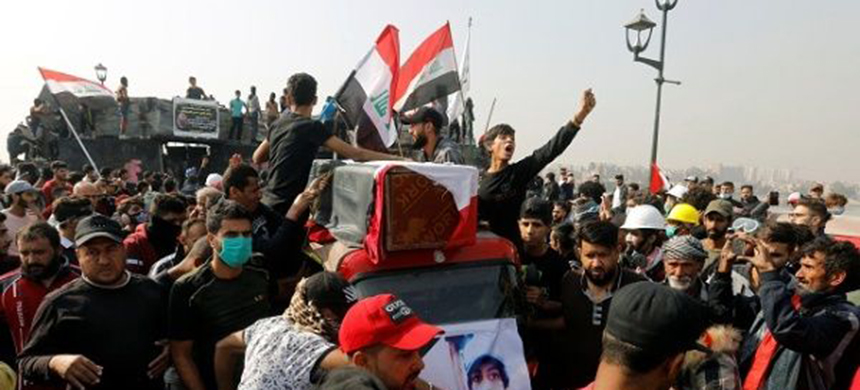 Iraqi protesters demonstrate against the government in Baghdad. (photo: Reuters)