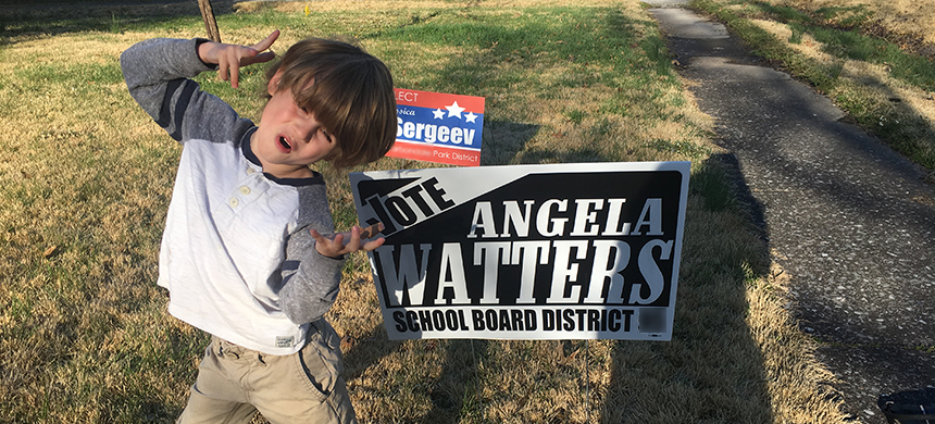 My son rockin' out next to my campaign sign. (photo: Angela Watters/RSN)