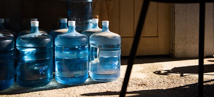 A decade ago, tap water began to burn people's eyes when they showered and leave white residue when they washed their cars. East Orosi, California's well is contaminated by runoff from orchards surrounding the town, and from leaking septic systems. (photo: Brittany Anzel App/US Water Alliance)